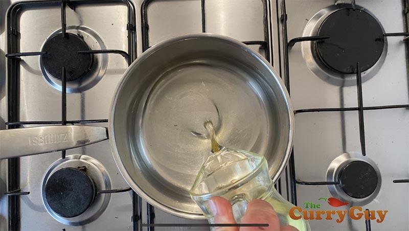 Adding oil to pan