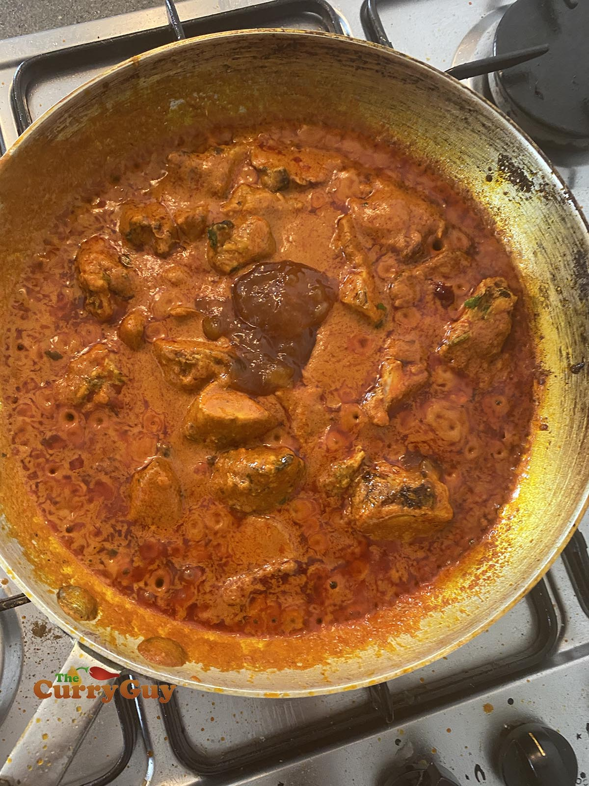 Adding mango chutney to the madras curry