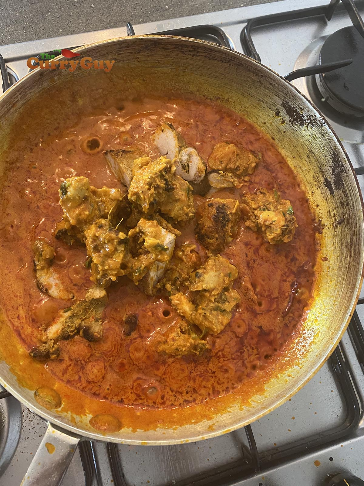 Adding chicken to the chicken madras curry