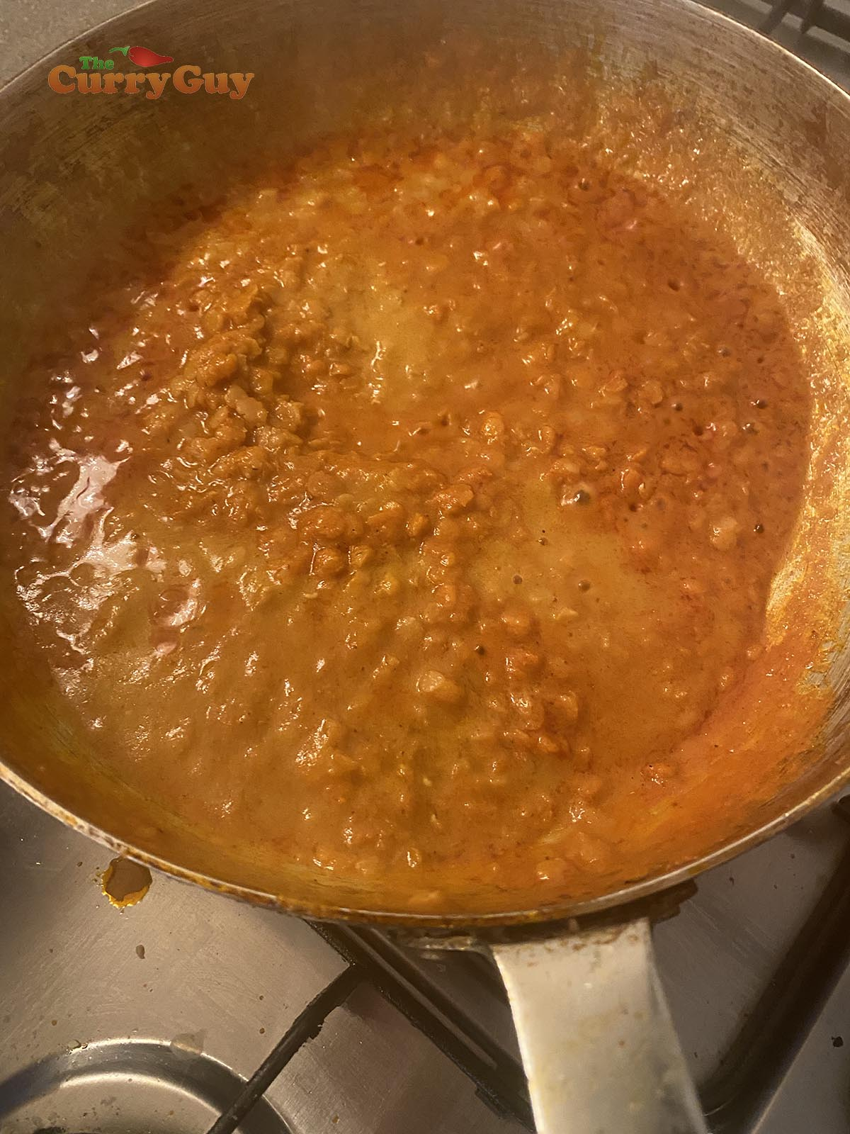 Adding base sauce and lentils