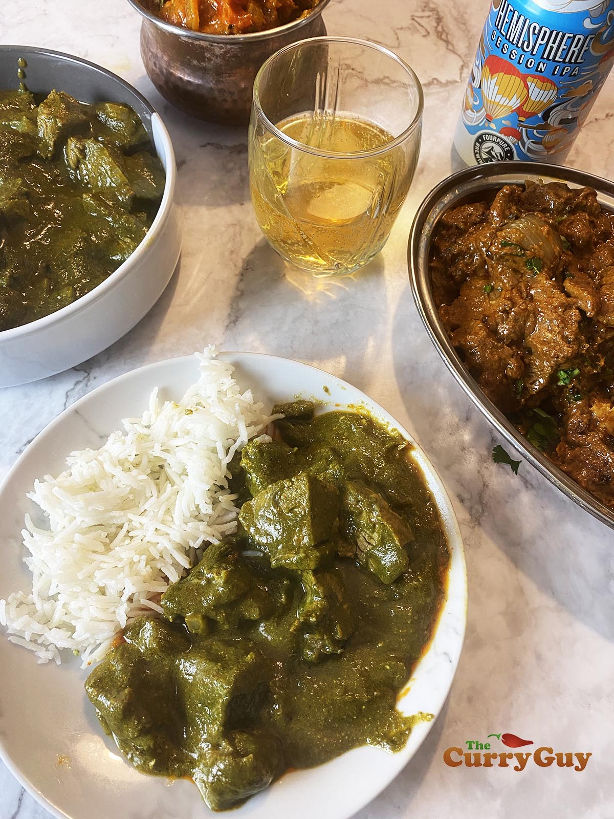 Finished lamb saag curry with other curries.