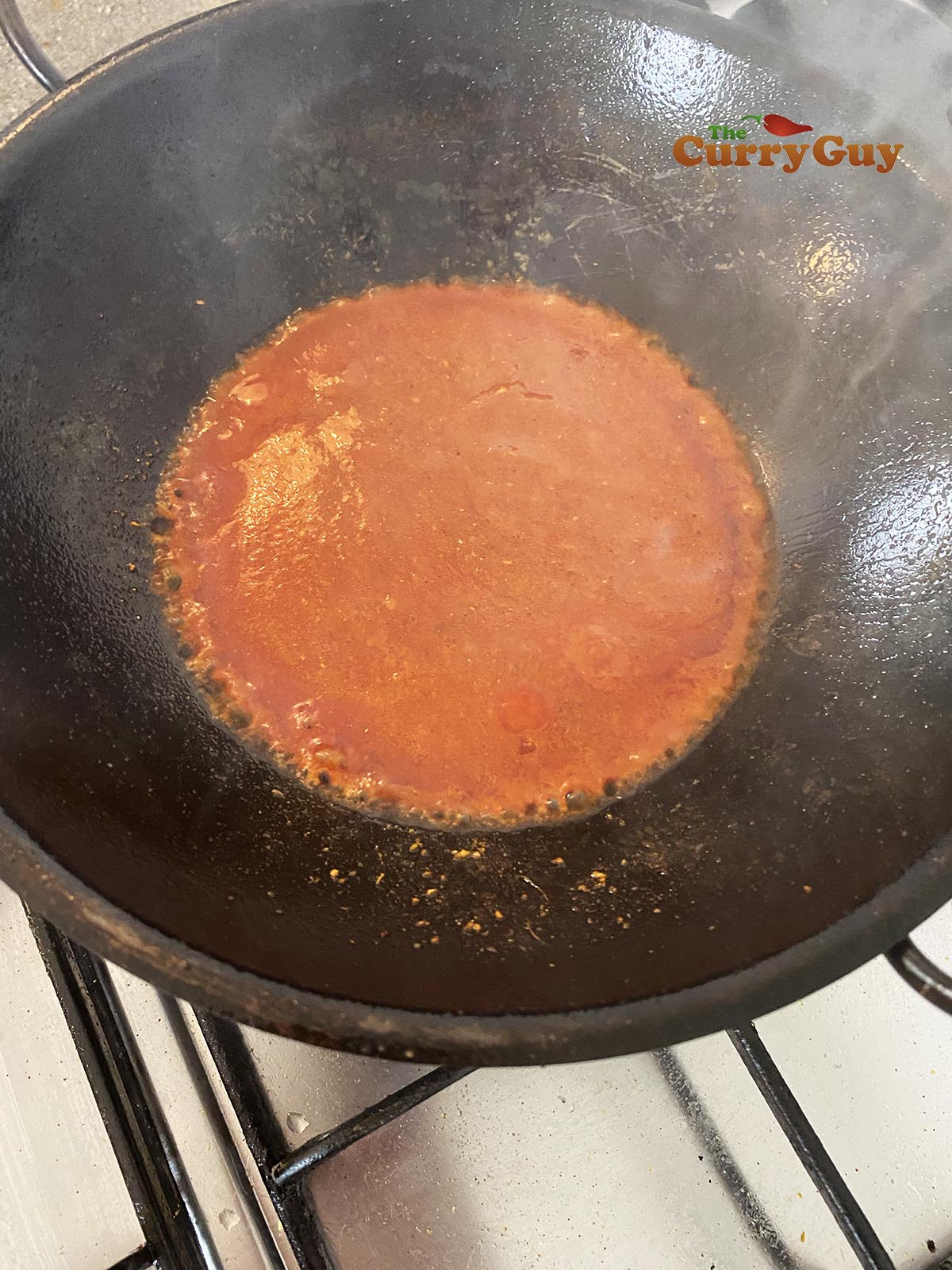 Stirring in the tomato puree