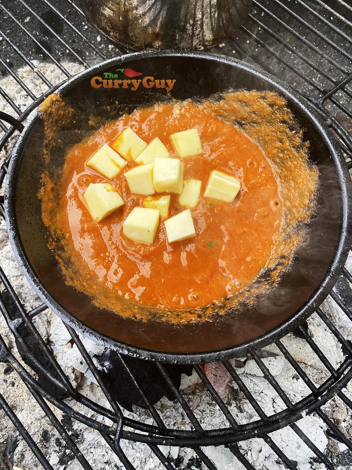 Adding paneer to balti bowl