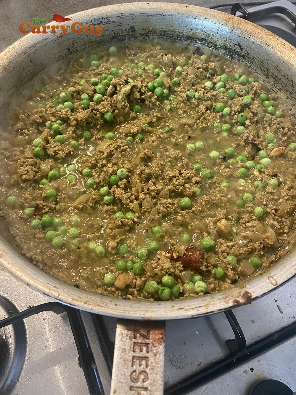 Adding the peas.