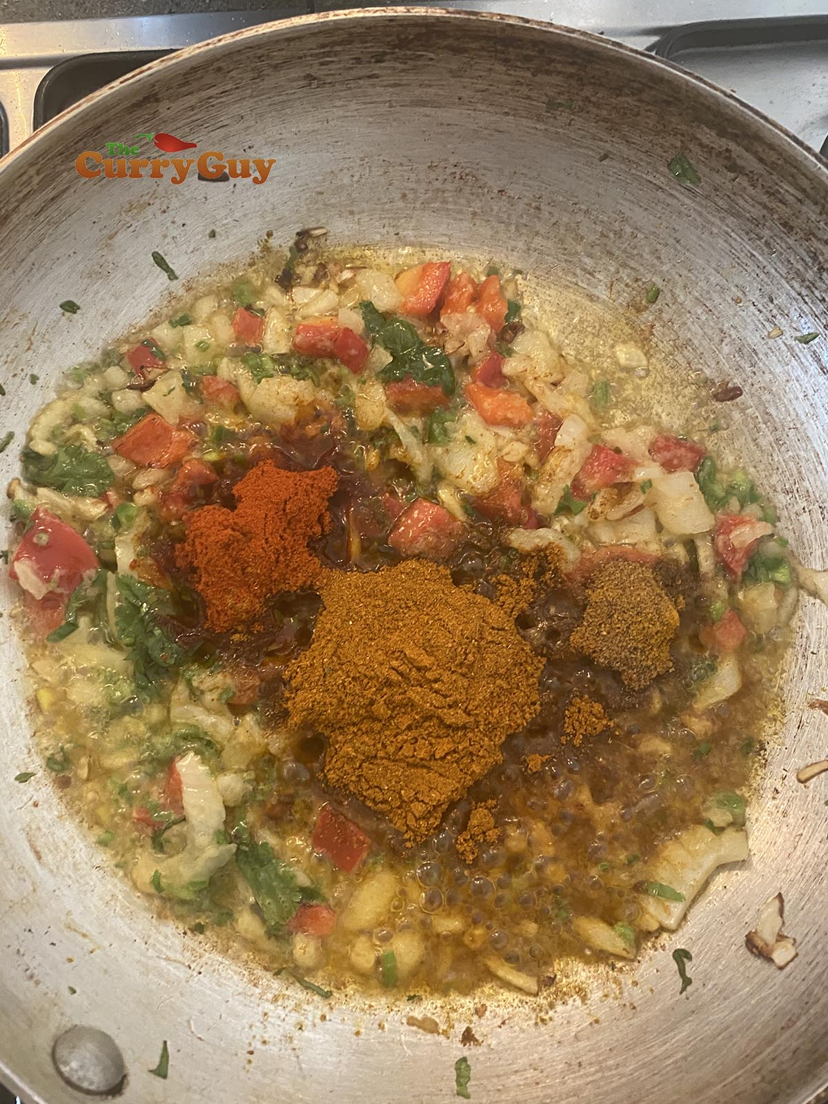 Adding ground spices to the pan