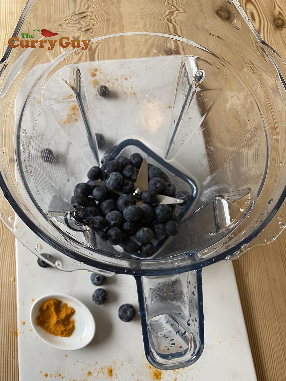 Adding the blueberries to the blender