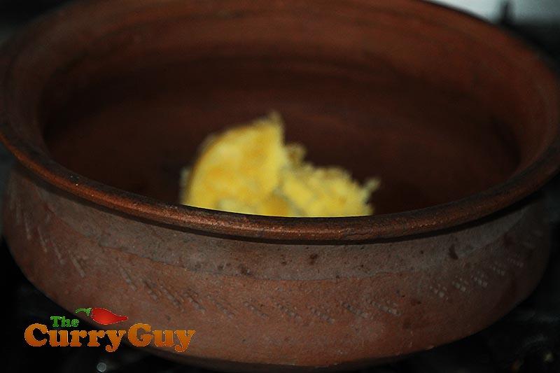 Making black chicken curry