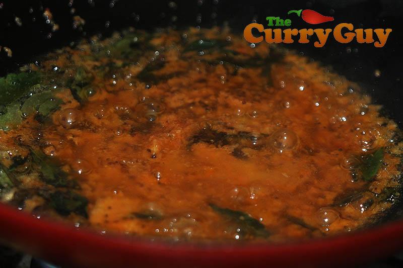 Making chicken drumstick curry