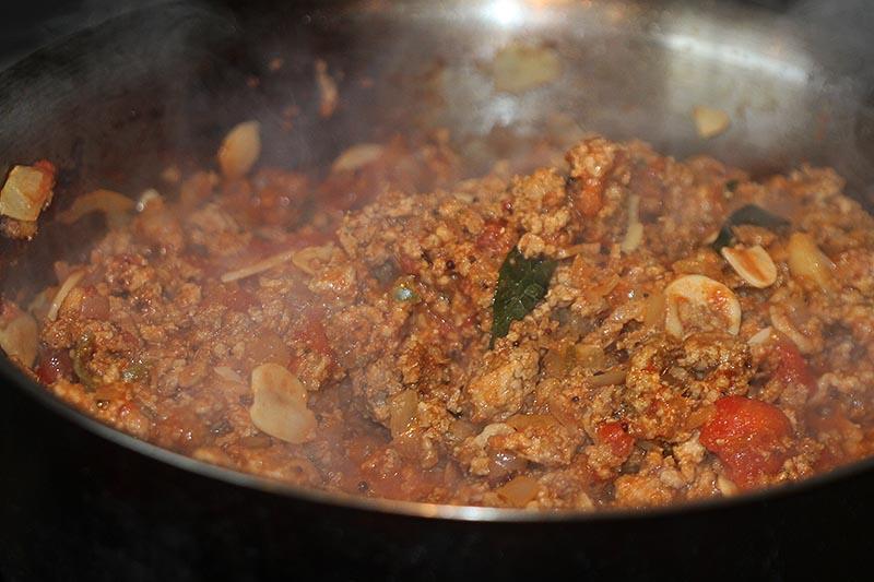 Making pork keema vindaloo wrap