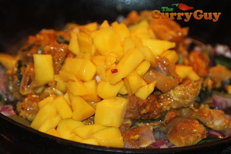 Making mackerel and mango curry