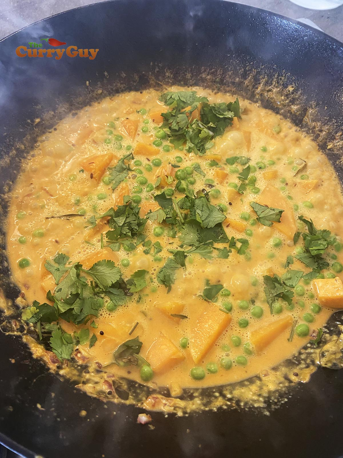 Butternut squash curry garnished with coriander (cilantro)