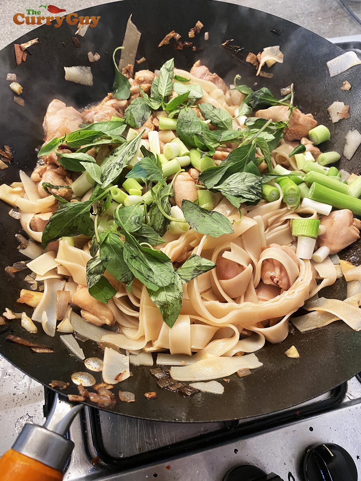 Adding noodles to pan