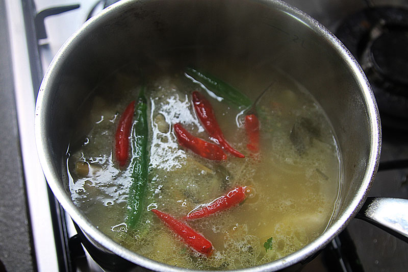 Adding chillies for spiciness in a Thai soup