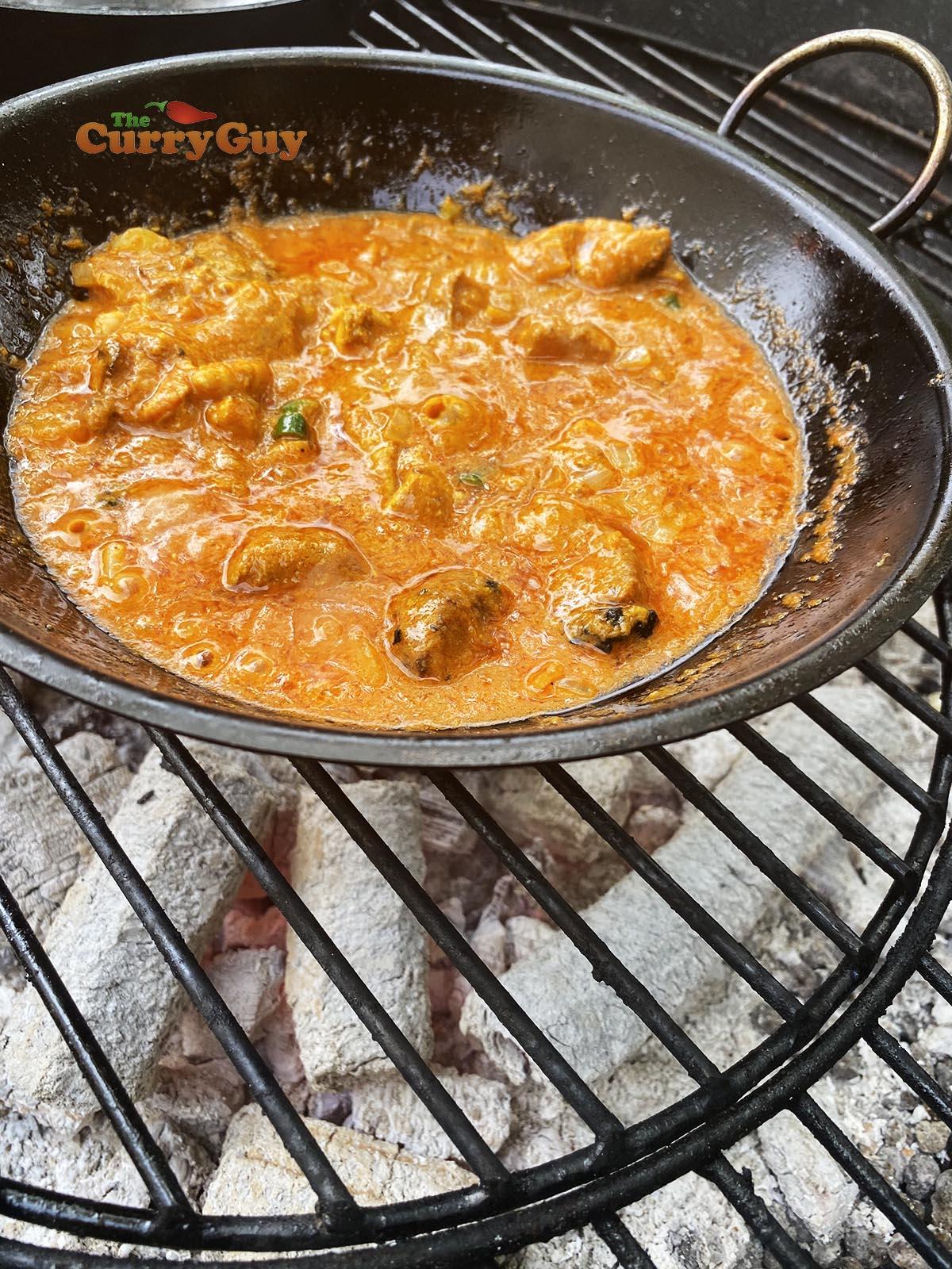 Adding chicken to pan