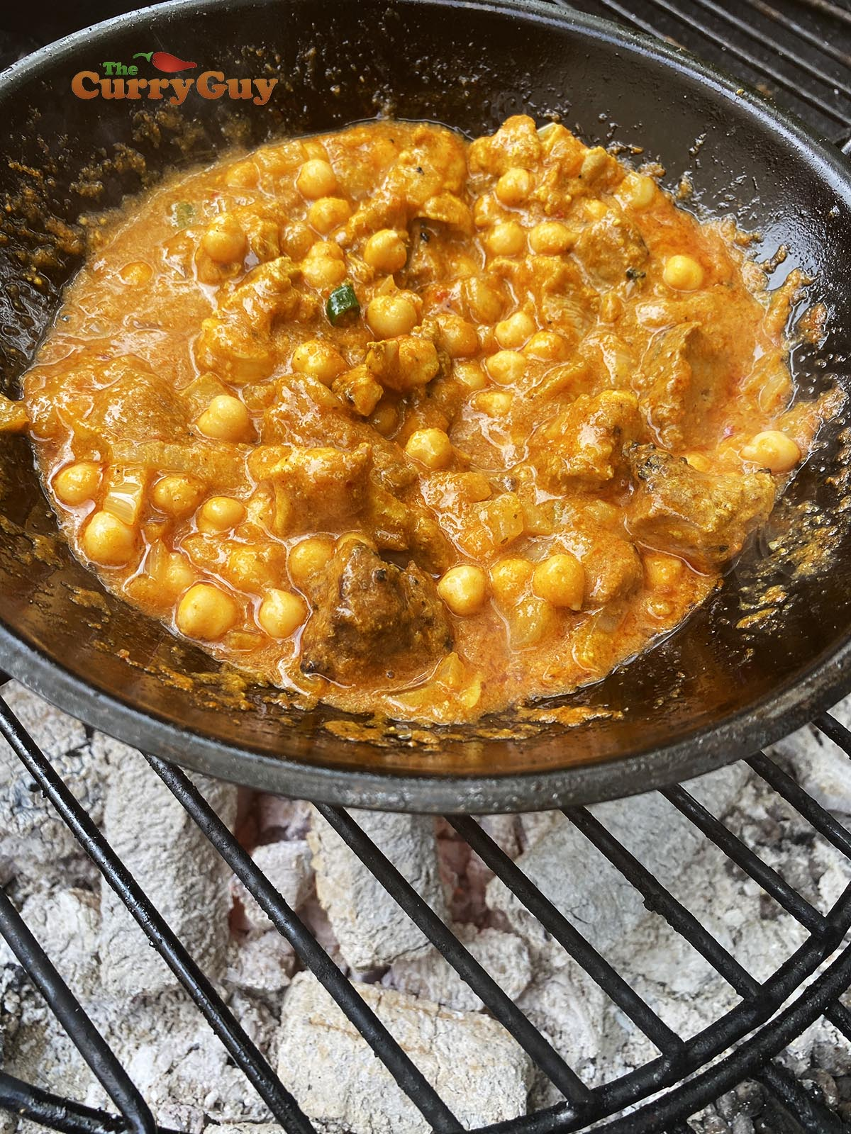 Adding chickpeas to the pan