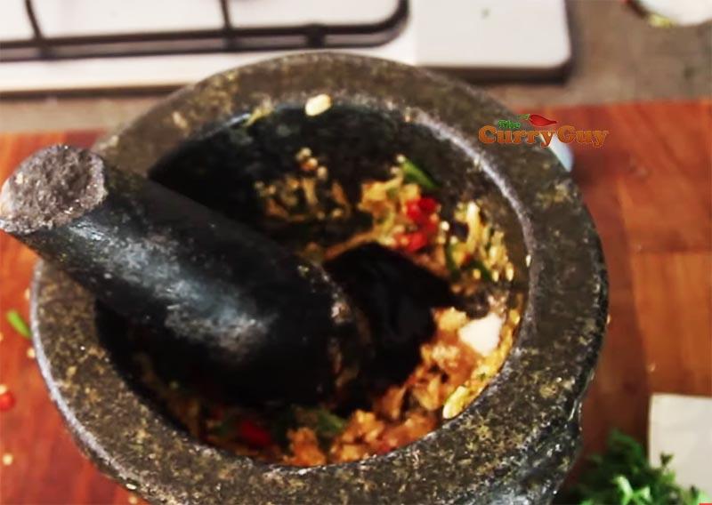 Making Thai seafood sauce for Thai Salt crust fish