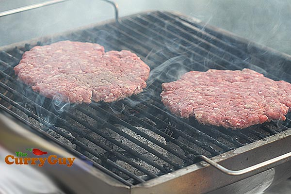 flame grilling burger patties