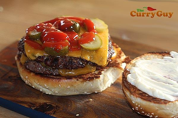 Adding ketchup to a burger