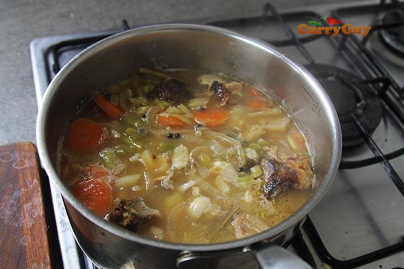 simmering pork stock