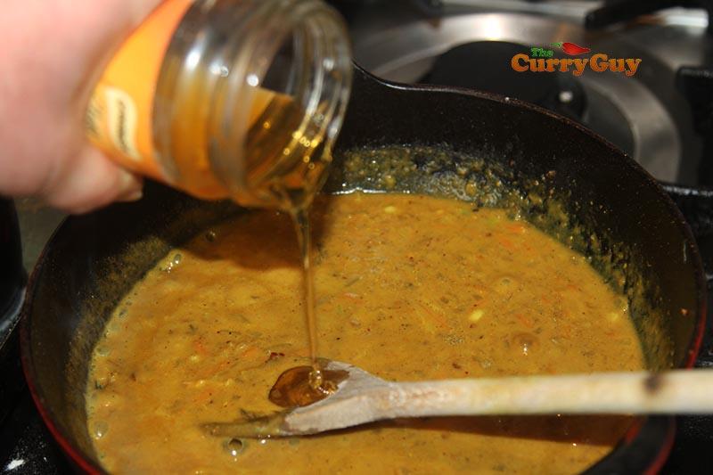 adding honey to katsu sauce
