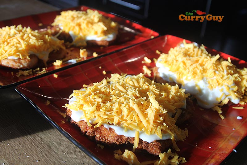 topping parmos with cheese