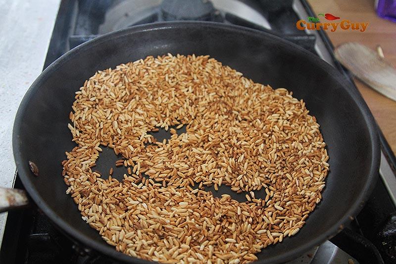 Roasting sticky rice.