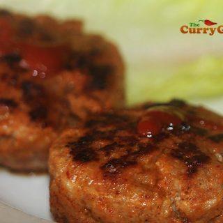 Adding hot sauce to sausages