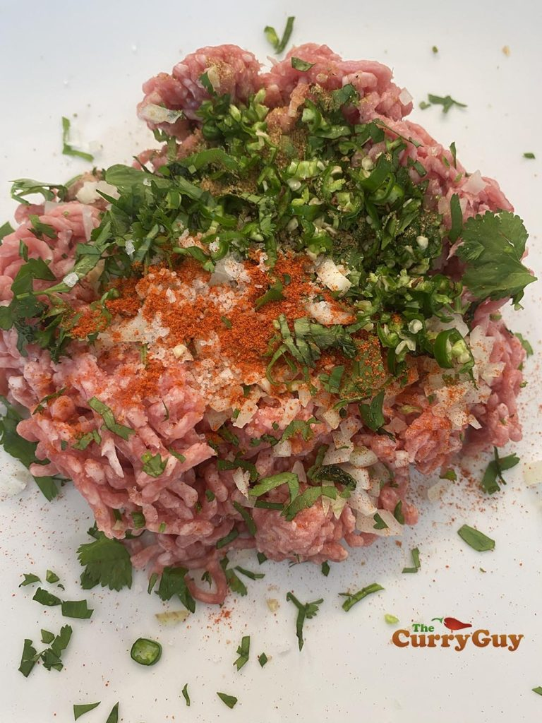 Adding ingredients to minced lamb