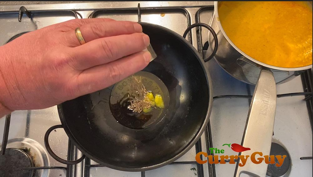 Melting ghee in a Balti Bowl