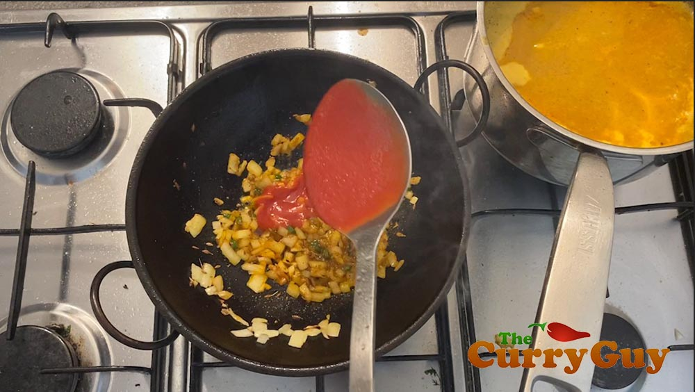 Adding tomato puree