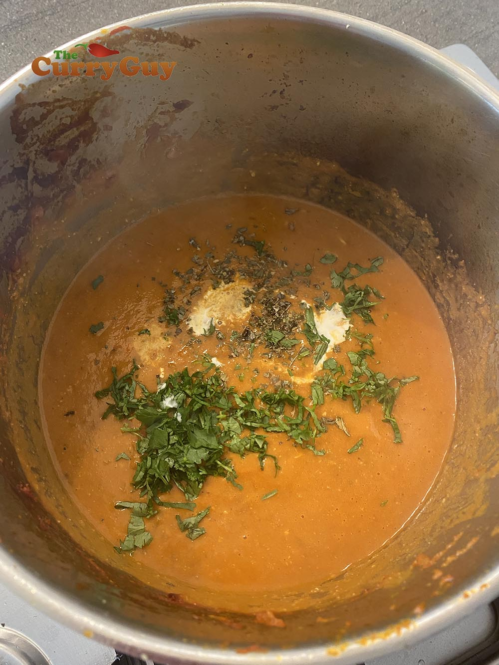 Adding fenugreek, coriander and cream