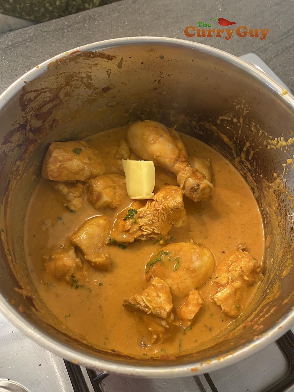 Returning chicken to pan