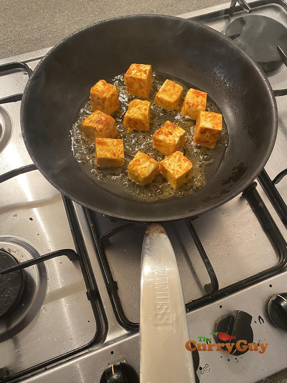 frying cubed paneer
