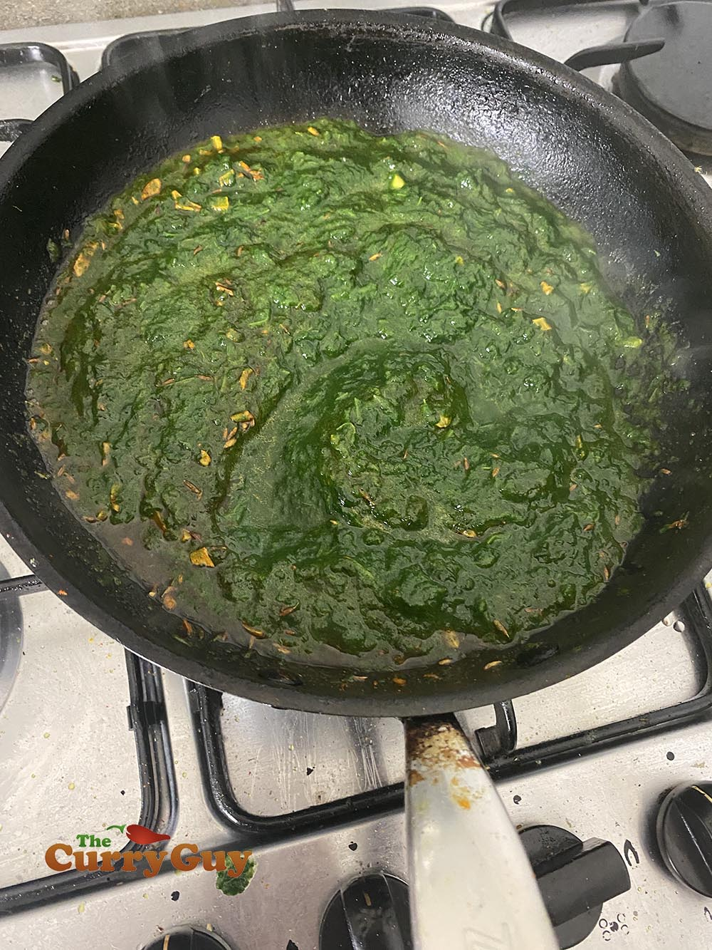 Adding pureed spinach to the pan