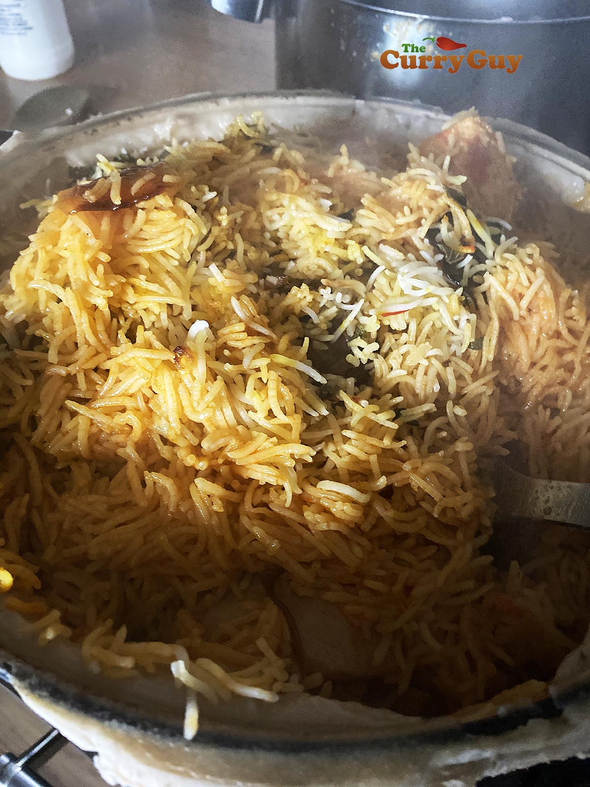 Stirring chicken biryani