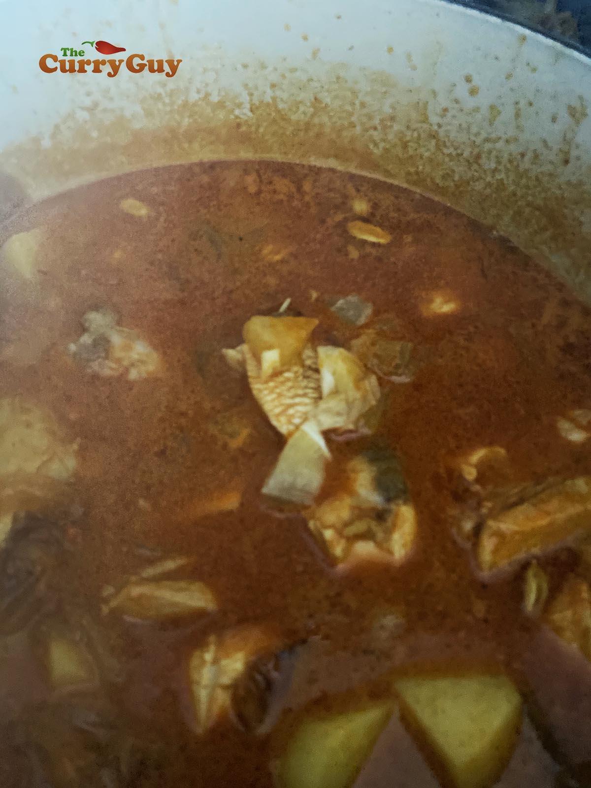 Simmering chicken biryani sauce