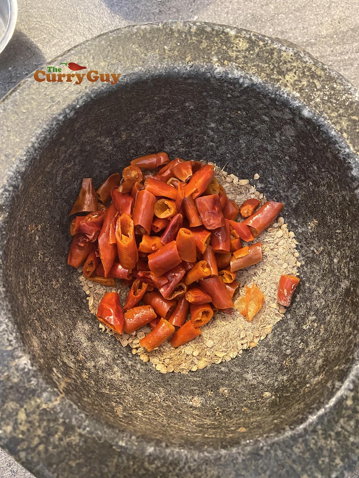 Pounding dried chillies