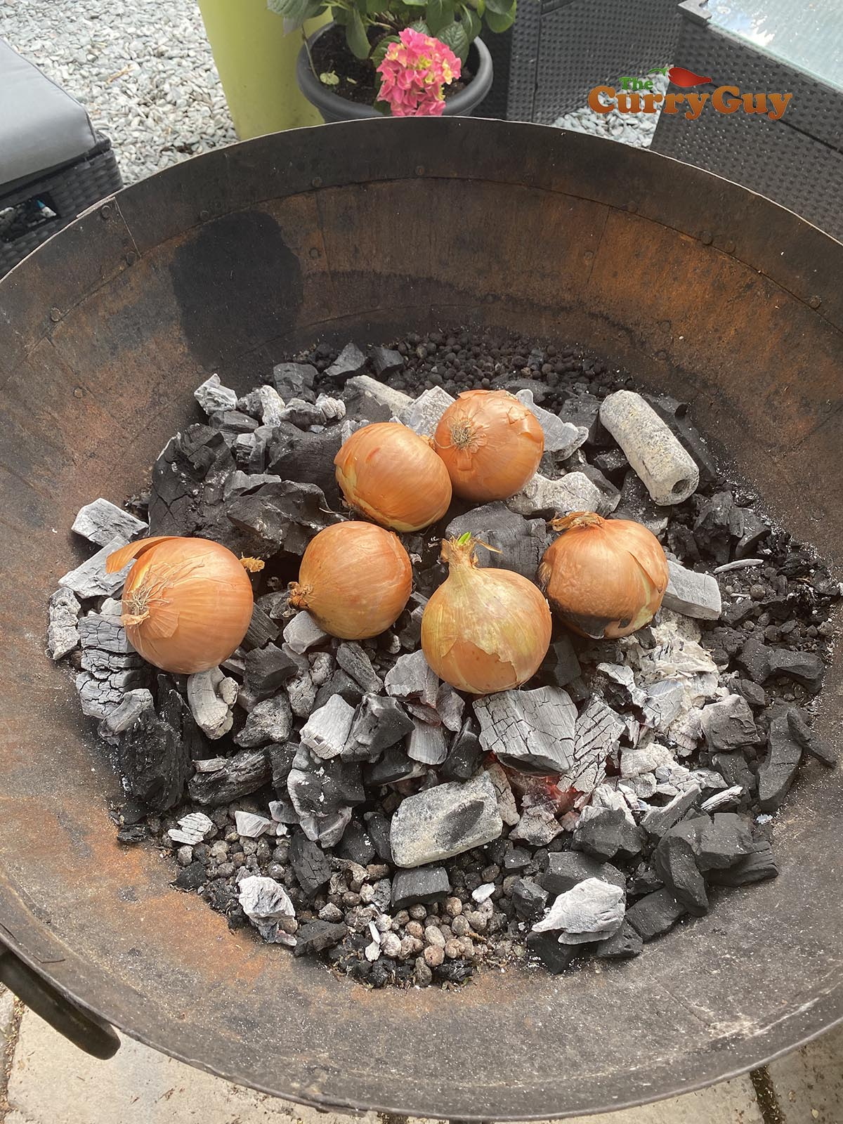 Roasting onions in the bbq embers