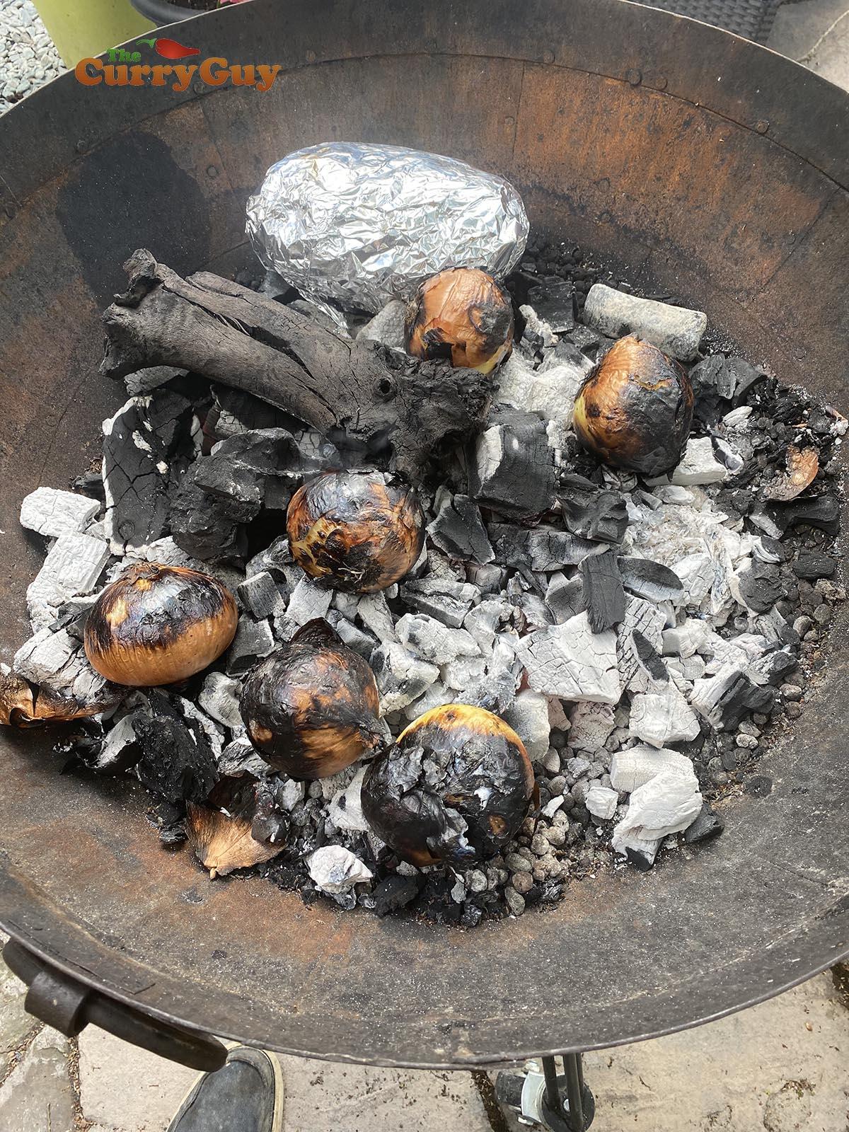 hobo pack of vegetables in the embers