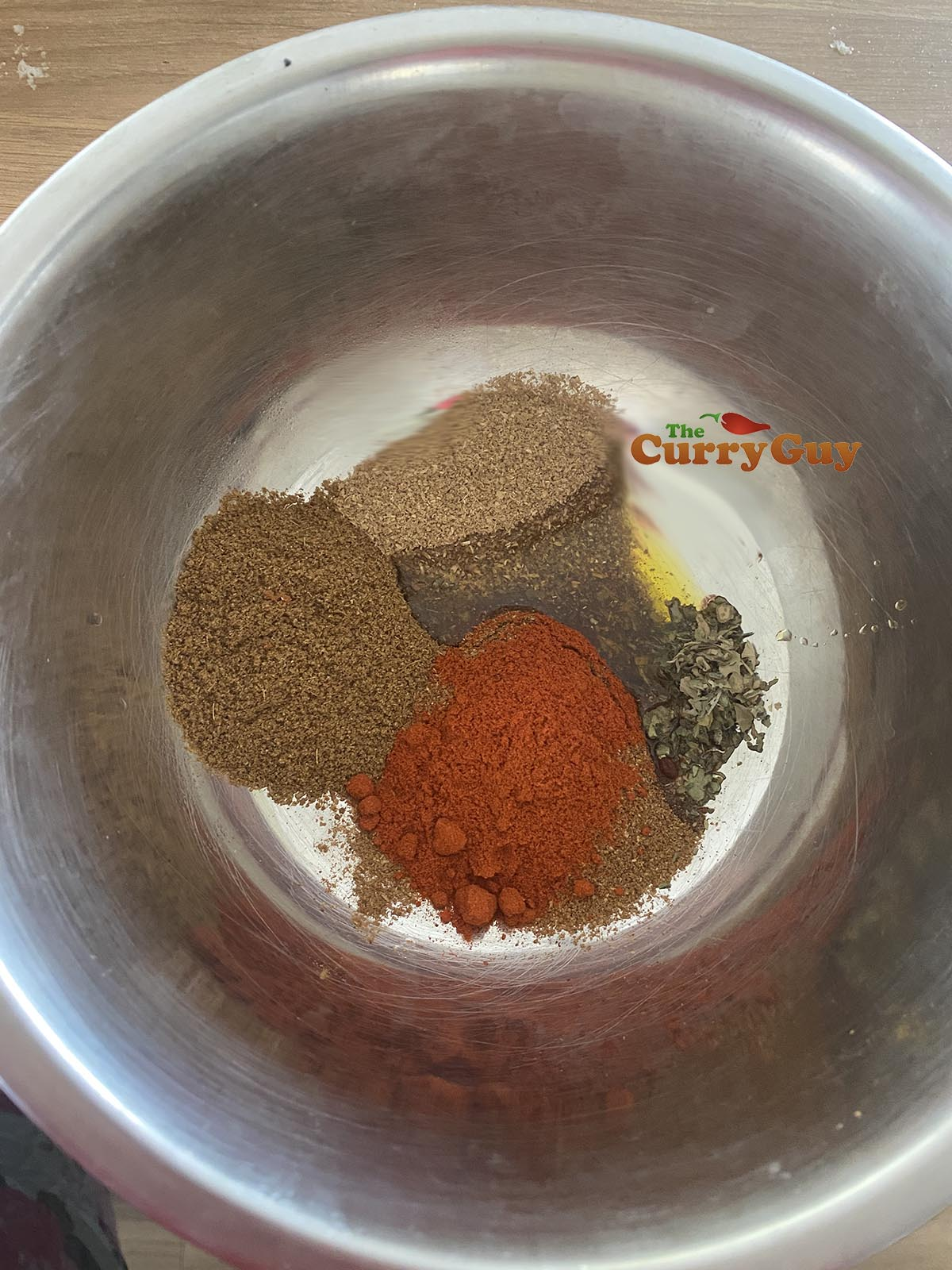 Making lamb tikka with spices