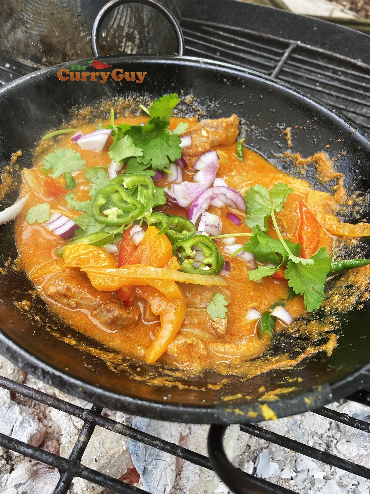 Garnishing with red onion and coriander