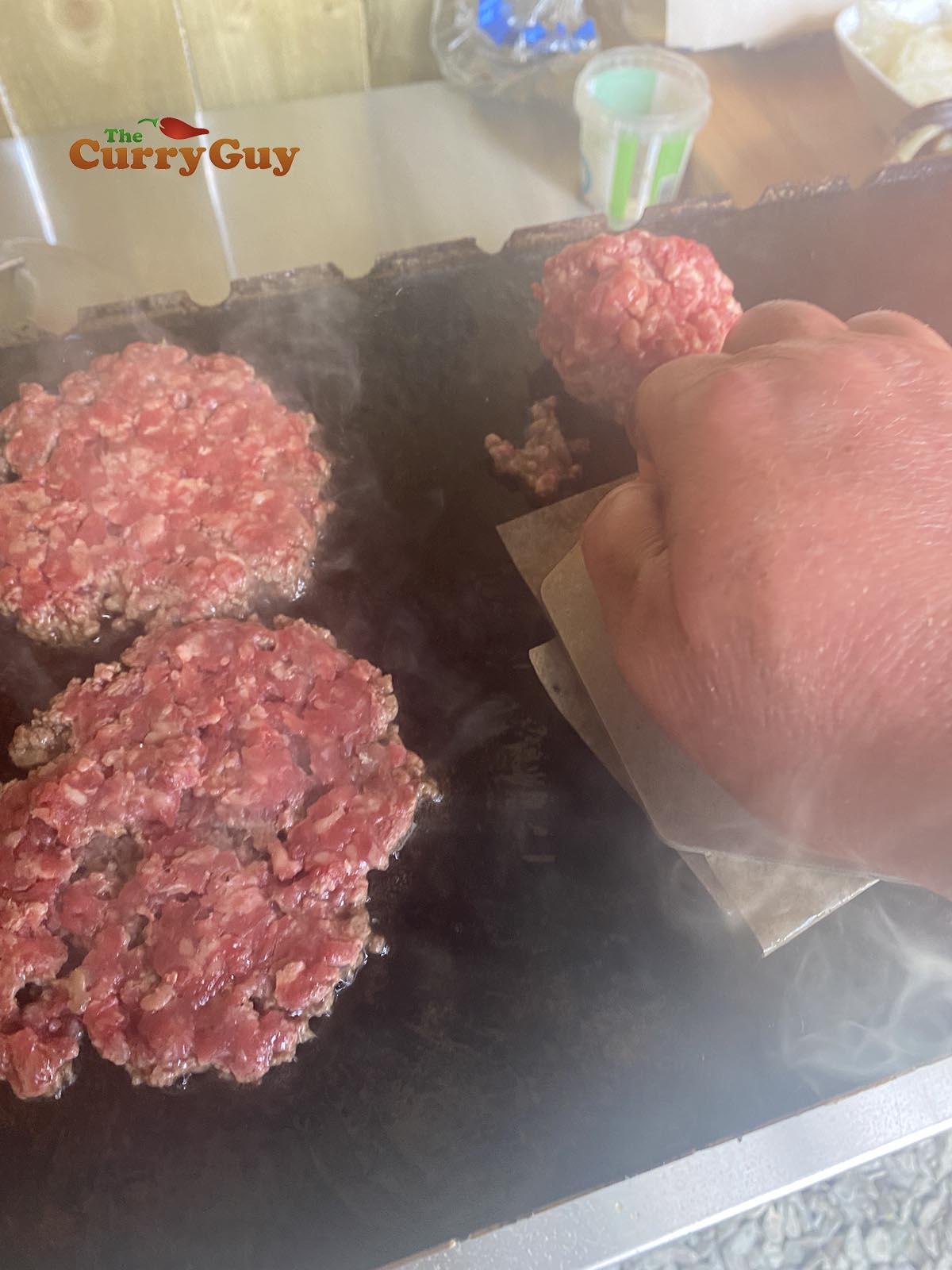Pressing burgers
