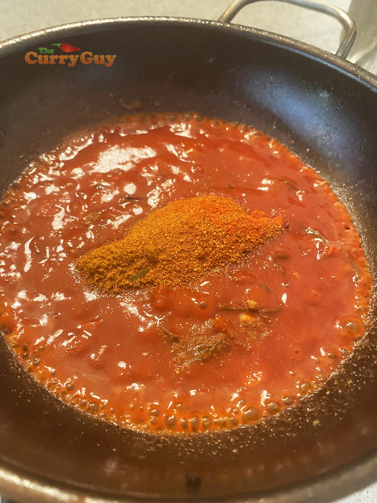 Stirring ground spices into the mix