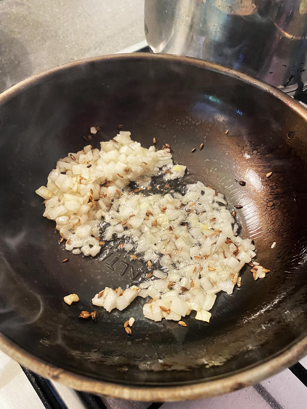 Stirring onions into the pan